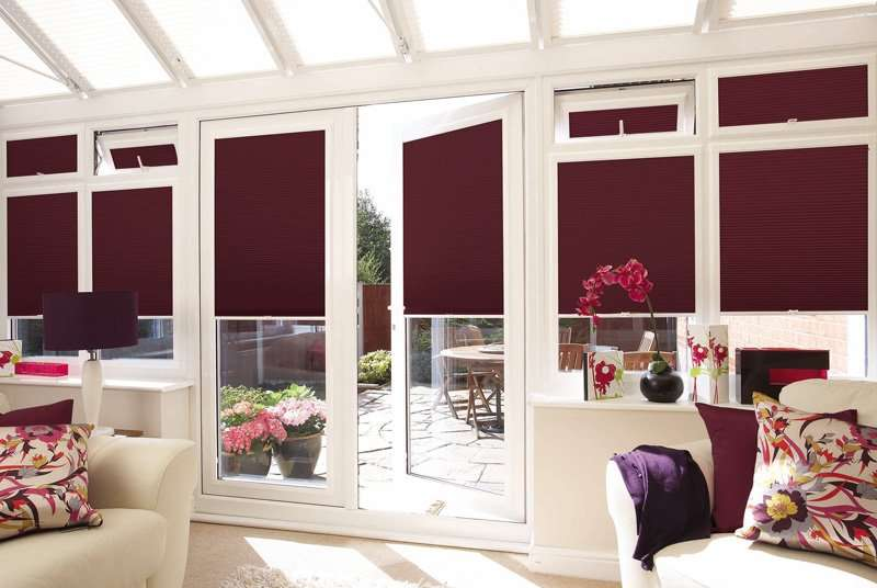 Red pleated blinds