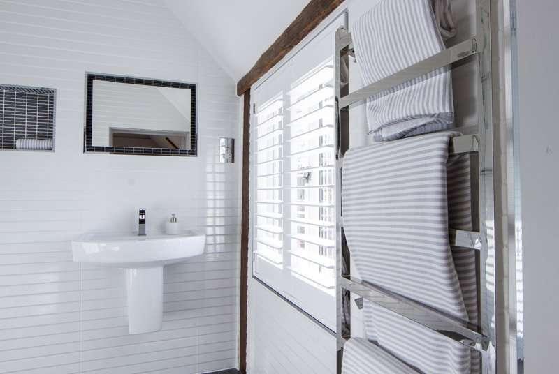 White wooden bathroom shutters